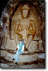 Jasmine Patel with a carving of the marriage of Shiva & Parvati in the Ellora caves. Avrangabad, India.