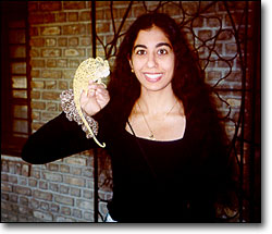 Jasmine Patel with a chameleon found outside Meher center. Ahmednagar, India.